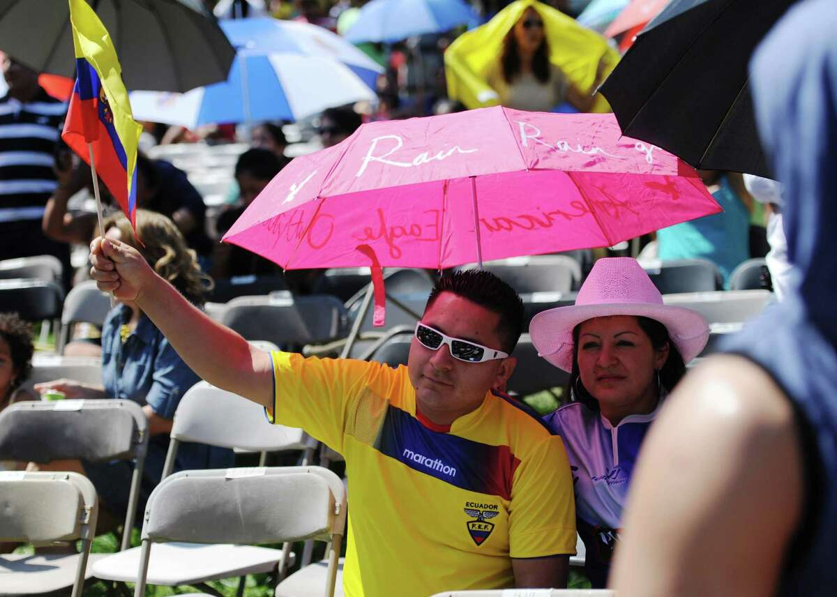 Jose Morocho, of Danbury, waves the flag of Ecuador at the Ecuadorian Festival at Ives Concert Park in Danbury, Conn. on Sunday, Aug. 11, 2013. The day-long festival attracted hundreds of people, who enjoyed food, games and music while celebrating the culture of Ecuador.
