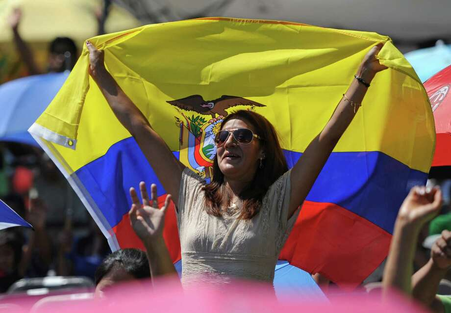 A festival-goer sports a flag of Ecuador at the Ecuadorian Festival at Ives Concert Park in Danbury, Conn. on Sunday, Aug. 11, 2013.  The day-long festival attracted hundreds of people, who enjoyed food, games and music while celebrating the culture of Ecuador. Photo: Tyler Sizemore / The News-Times