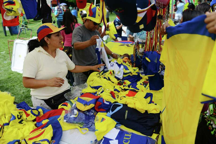 Blanca and Jorge Quito, of New York, sell merchandise at the Ecuadorian Festival at Ives Concert Park in Danbury, Conn. on Sunday, Aug. 11, 2013.  The day-long festival attracted hundreds of people, who enjoyed food, games and music while celebrating the culture of Ecuador. Photo: Tyler Sizemore / The News-Times