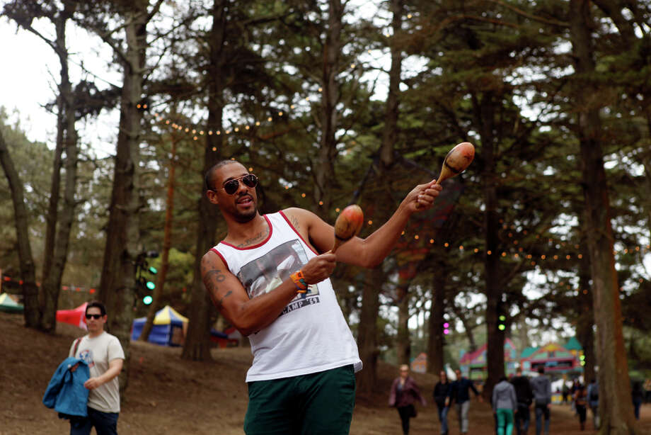 Jamil Harrell uses maracas to grab Outside Land Festival goers attention and direct them to food in San Francisco, Calif. on Sunday, August 11, 2013. Photo: Katie Meek / The Chronicle / ONLINE_YES