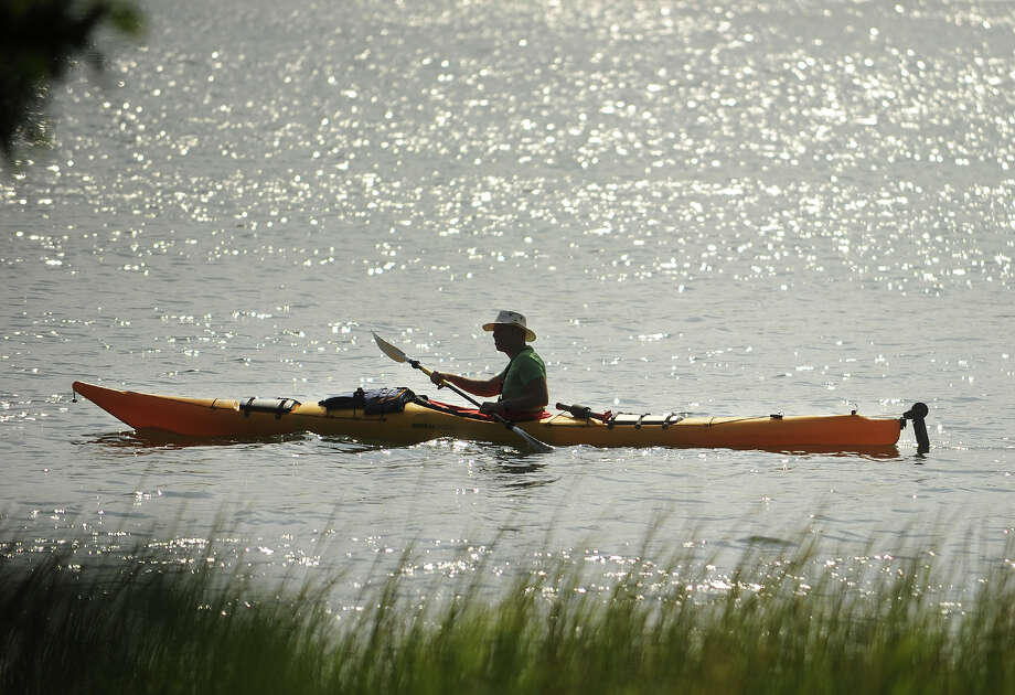 A kayaker paddles along the shore of Ash Creek in Fairfield, Conn, on Sunday, August 11, 2013. Photo: Brian A. Pounds / Connecticut Post