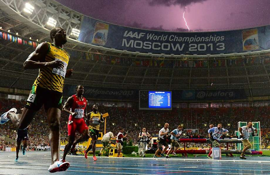 Jamaica's Usain Bolt beats Justin Gatlin and Nesta Carter to take first place in the 100 meters. Photo: Olivier Morin, AFP/Getty Images