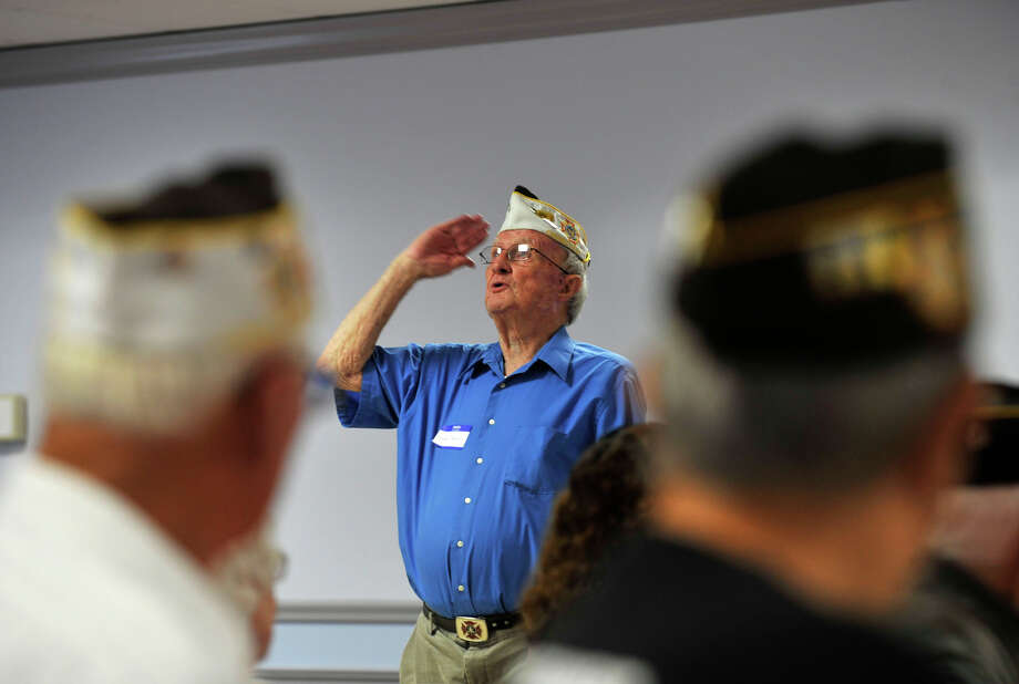 James Nestor, one of the founders of the Springdale VFW Post 9617, salutes his fallen fellow soldiers during the post's anniversary picnic at the Belltown fire house in Stamford on Sunday, Aug. 11, 2013. Photo: Jason Rearick / Stamford Advocate