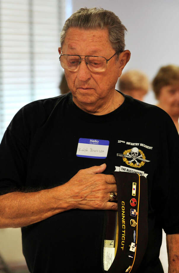 Ralph Bocuzzo listens as taps are played for his fellow fallen soldiers during the Springdale VFW Post 9617 anniversary picnic at the Belltown fire house in Stamford on Sunday, Aug. 11, 2013. Photo: Jason Rearick / Stamford Advocate