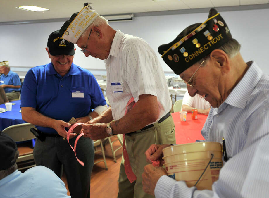 From left, Mike Macri, Fred Drenckhahn and Marco Pensiero collect raffle tickets during the Springdale VFW Post 9617 anniversary picnic at the Belltown fire house in Stamford on Sunday, Aug. 11, 2013. Photo: Jason Rearick / Stamford Advocate