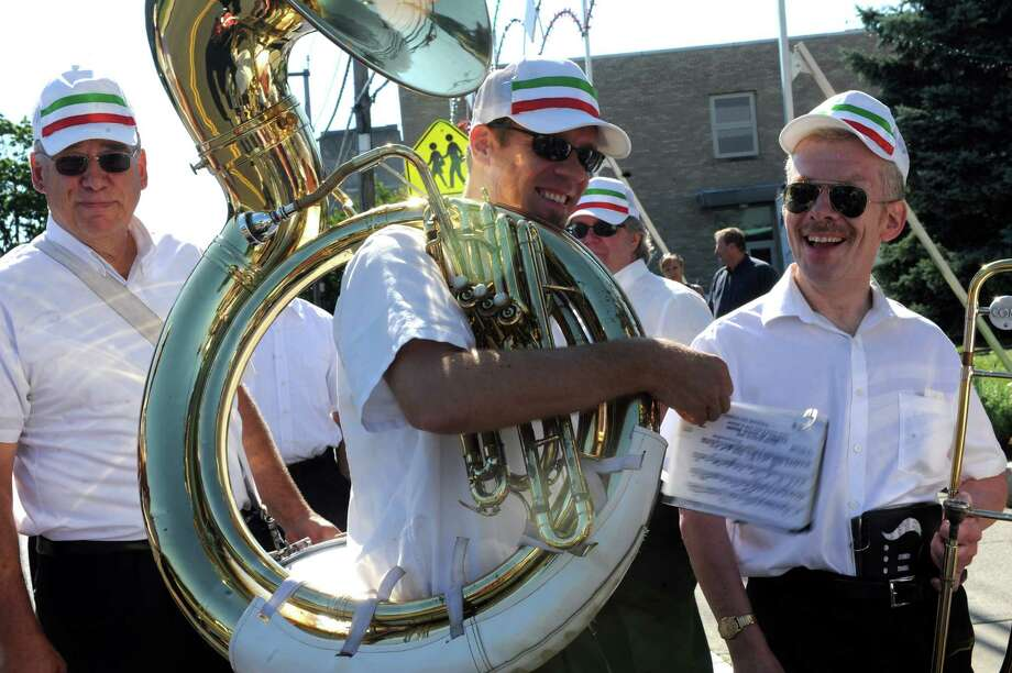 Tim Lemek, center, of Danbury, with his tuba, with the Dixie Dandies at the annual Saint Roch parade at Chickahominy, in Greenwich, Conn., Sunday, August 11, 2013. Photo: Helen Neafsey / Greenwich Time
