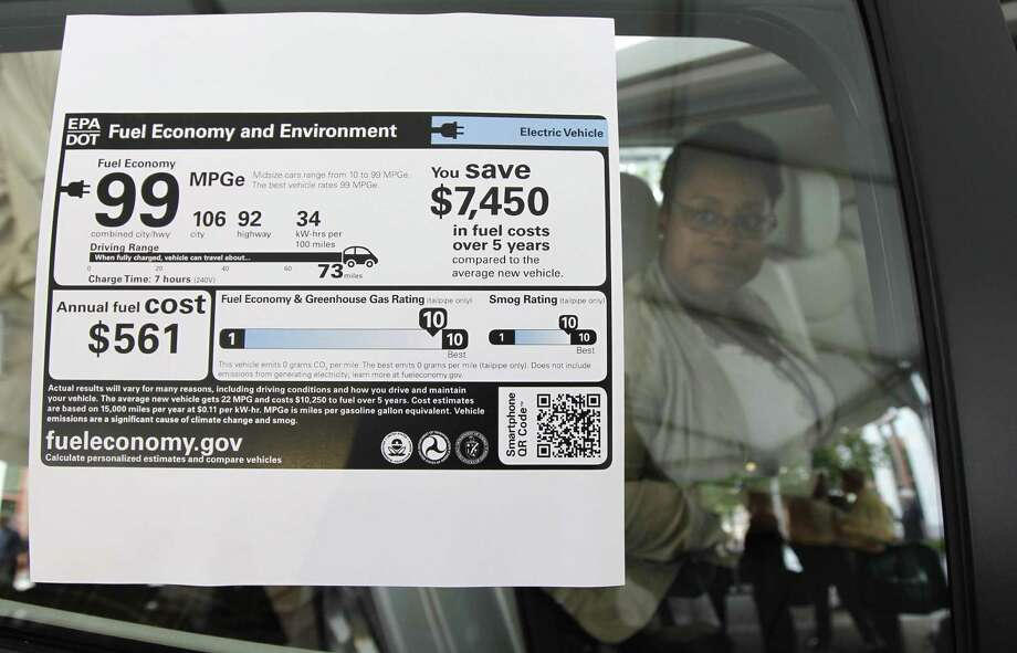 A new car's window sticker will show the estimated fuel cost to drive it, but that figure may not be accurate depending on how many miles you drive. Photo: Associated Press