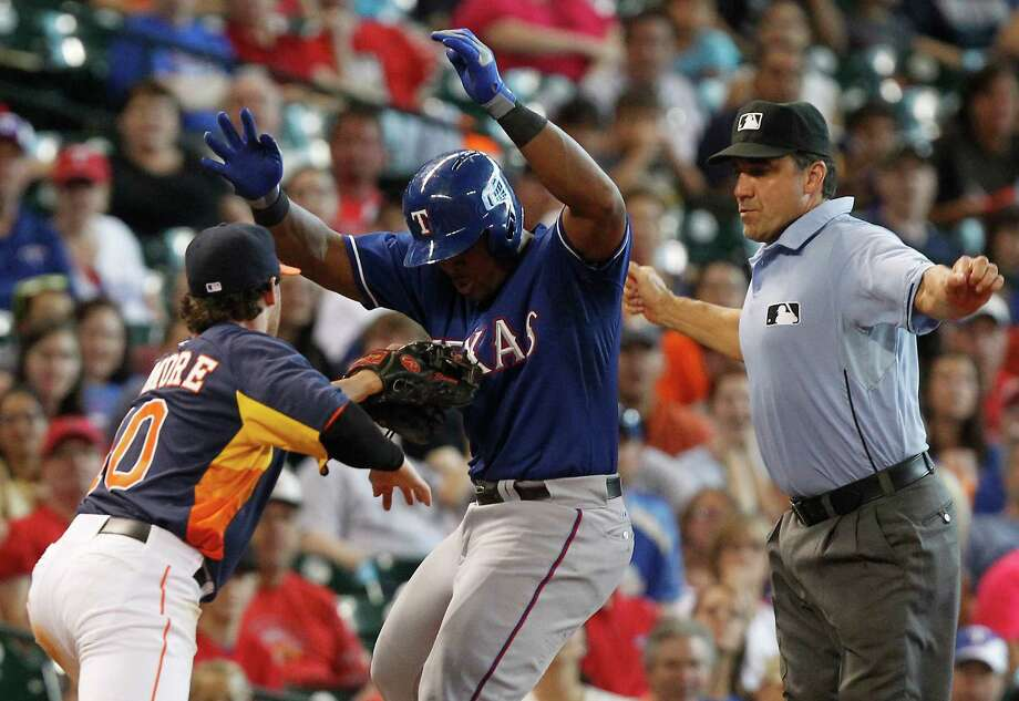 Texas Rangers' Adrian Beltre (29) is tagged out by Houston Astros second baseman Jake Elmore (10) during a run down in the ninth inning of a baseball game, Sunday, Aug. 11, 2013, in Houston. (AP Photo/Patric Schneider) Photo: Patric Schneider, Associated Press / FR170473 AP