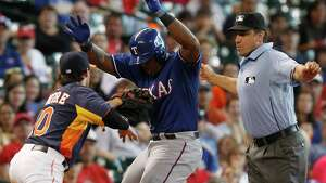 Texas Rangers' Adrian Beltre (29) is tagged out by Houston Astros second baseman Jake Elmore (10) during a run down in the ninth inning of a baseball game, Sunday, Aug. 11, 2013, in Houston. (AP Photo/Patric Schneider)