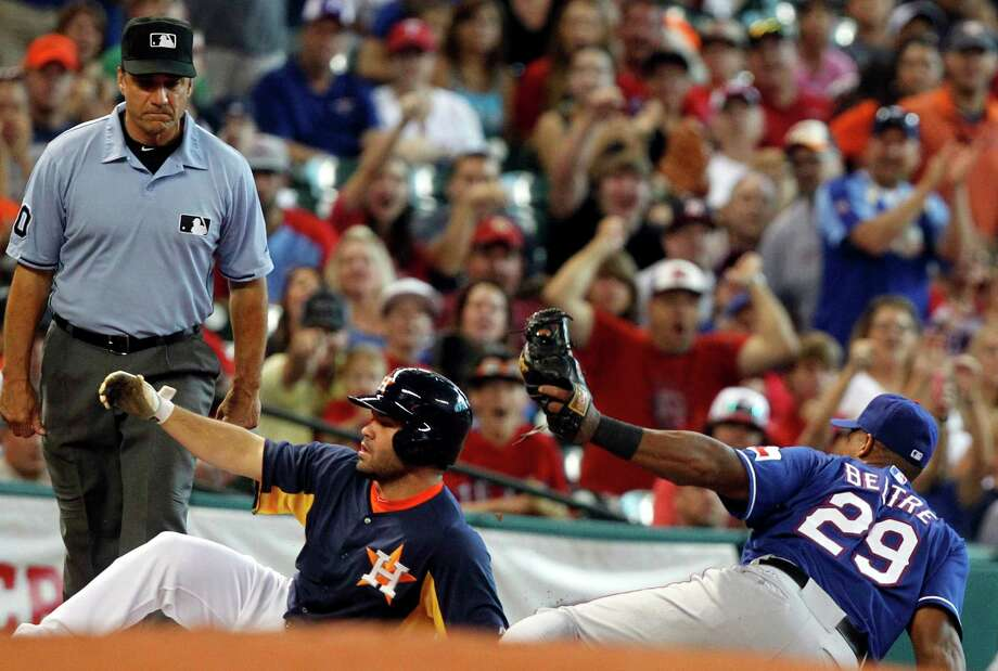 Texas Rangers third baseman Adrian Beltre (29) tags out Houston Astros' Jose Altuve on an attempted triple in the first inning during a baseball game on Sunday, Aug. 11, 2013, in Houston. (AP Photo/Patric Schneider) Photo: Patric Schneider, Associated Press / FR170473 AP