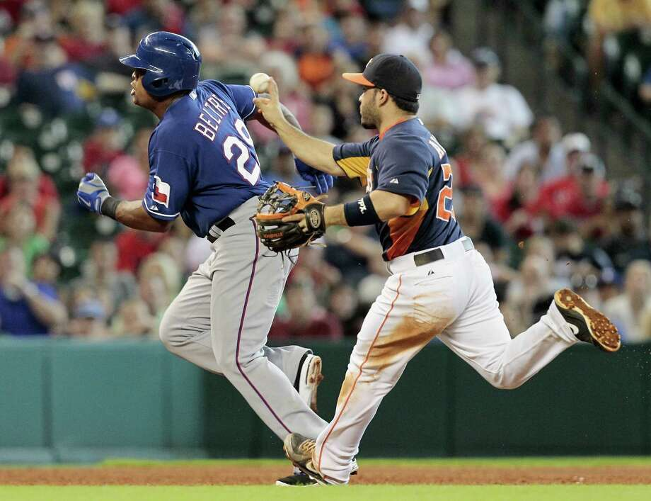 Adrian Beltre #29 of the Texas Rangers gets caught in a rundown with Jose Altuve #27 of the Houston Astros in the ninth inning at Minute Maid Park on August 11, 2013 in Houston. Photo: Bob Levey, Getty Images / 2013 Getty Images