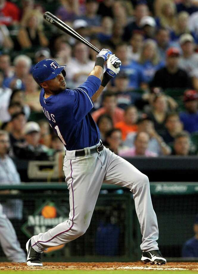 Texas Rangers' Alex Rios hits a double to right field scoring teammate Elvis Andrus during the sixth inning of a baseball game, Sunday, Aug. 11, 2013, in Houston. (AP Photo/Patric Schneider) Photo: Patric Schneider, Associated Press / FR170473 AP