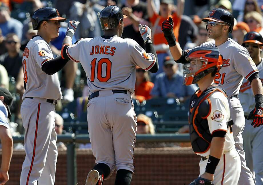 Adam Jones is congratulated after his three-run homer in the ninth capped Baltimore's victory. Photo: Brant Ward, The Chronicle