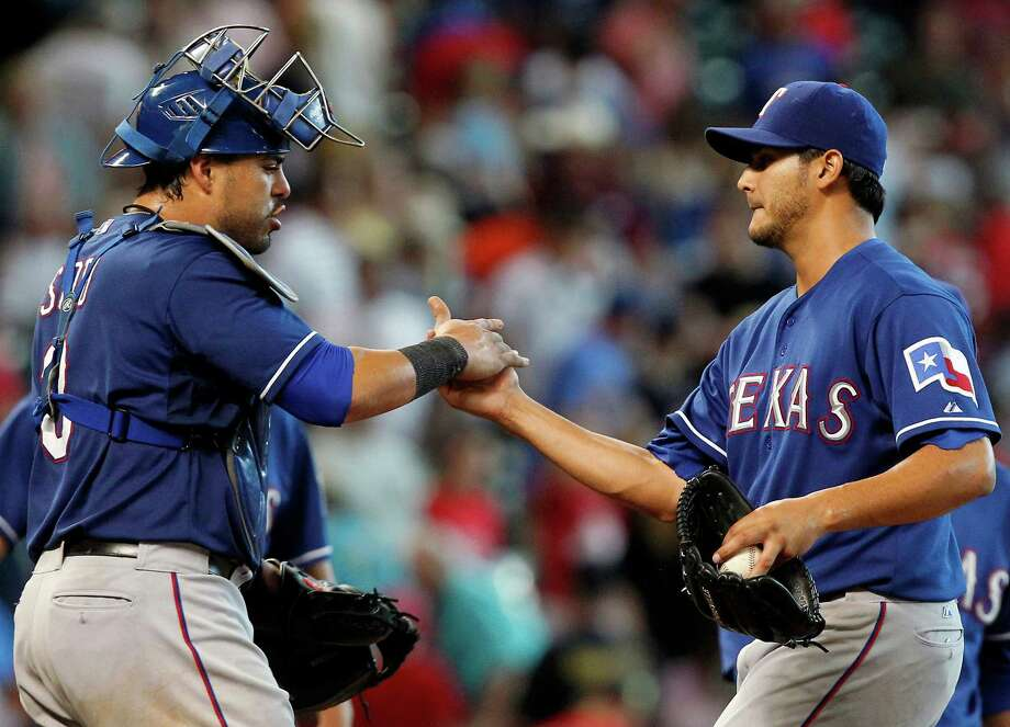 Texas Rangers starting pitcher Martin Perez, right, is congratulated by catcher Geovany Soto (8) after defeating the Houston Astros 6-1 during a baseball game, Sunday, Aug. 11, 2013, in Houston. (AP Photo/Patric Schneider) Photo: Patric Schneider, Associated Press / FR170473 AP