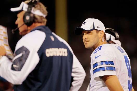 OAKLAND, CA - AUGUST 9:  Quarterback Tony Romo #9 of the Dallas Cowboys keeps track of the play calling against the Oakland Raiders late in the fourth quarter of a preseason game on August 9, 2013 at O.co Coliseum in Oakland, California. Photo: Brian Bahr, Getty Images / 2013 Getty Images