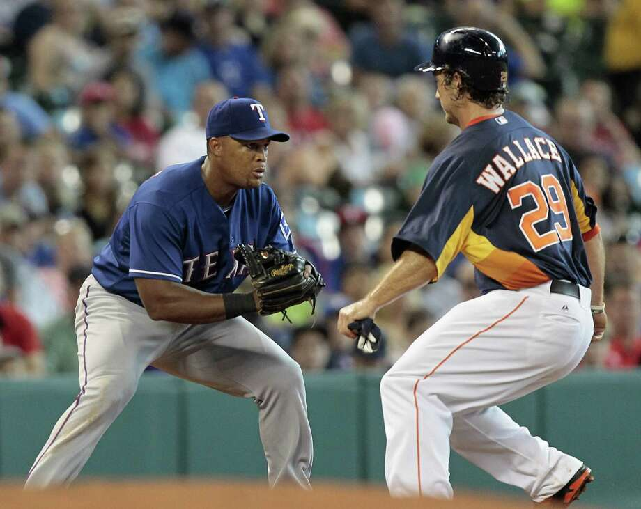 Adrian Beltre #29 of the Texas Rangers tags out Brett Wallace #29 of the Houston Astros  in the fifth inning at Minute Maid Park on August 11, 2013 in Houston. Photo: Bob Levey, Getty Images / 2013 Getty Images