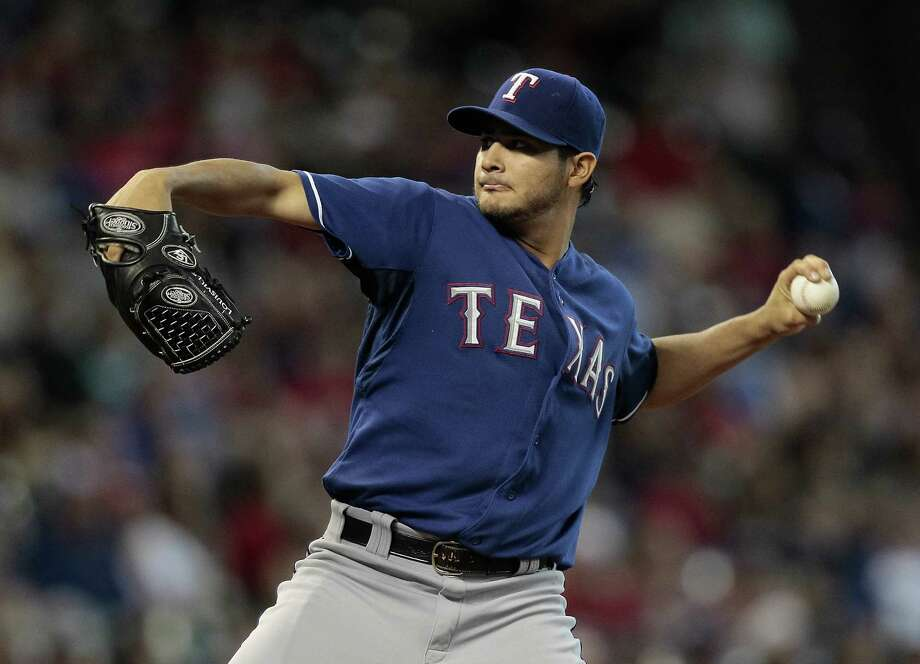 Martin Perez #33 of the Texas Rangers throws in the first inning against the Houston Astros at Minute Maid Park on August 11, 2013 in Houston. Photo: Bob Levey, Getty Images / 2013 Getty Images