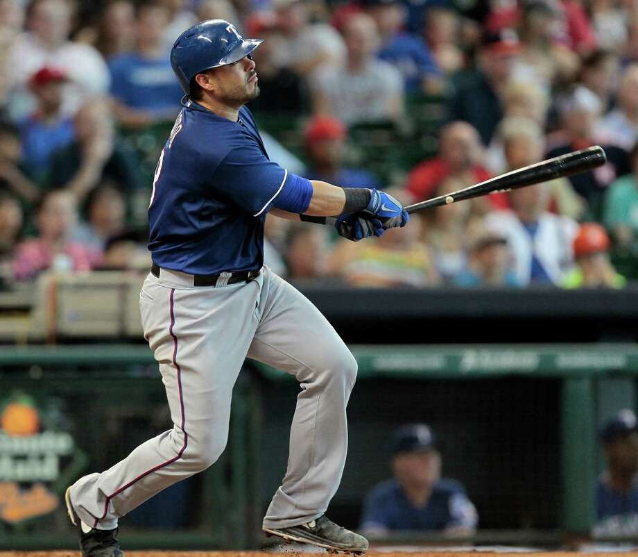 Geovany Soto #8 of the Texas Rangers hits a ground rule double in the fifth inning against the Houston Astros at Minute Maid Park on August 11, 2013 in Houston. Photo: Bob Levey, Getty Images / 2013 Getty Images
