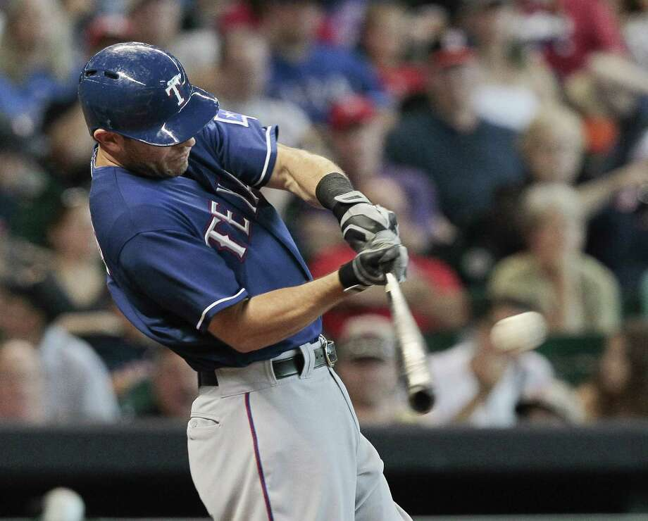 Ian Kinsler #5 of the Texas Rangers flies out in the sixth inning against the Houston Astros at Minute Maid Park on August 11, 2013 in Houston. Photo: Bob Levey, Getty Images / 2013 Getty Images