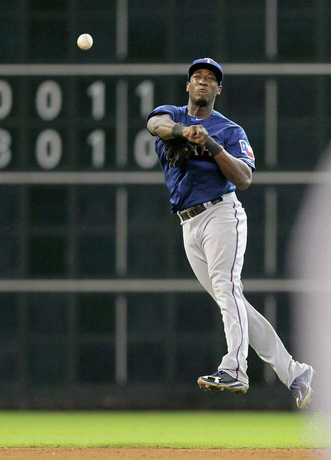 Jurickson Profar #13 of the Texas Rangers throws to first base against the Houston Astros at Minute Maid Park on August 11, 2013 in Houston. Photo: Bob Levey, Getty Images / 2013 Getty Images
