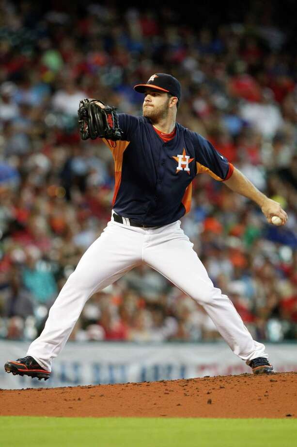 Houston Astros starting pitcher Dallas Keuchel (60) throws in the fifth inning during a baseball game against the Texas Rangers, Sunday, August 11, 2013, in Houston. (AP Photo/Patric Schneider) Photo: Patric Schneider, Associated Press / FR170473 AP