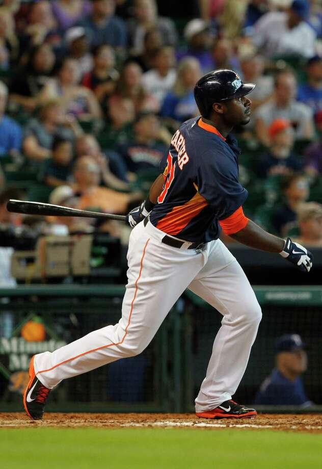 Houston Astros' Chris Carter hits a solo home run during the ninth inning of a baseball game against the Texas Rangers, Sunday, Aug. 11, 2013, in Houston. The Rangers defeated the Astros 6-1. (AP Photo/Patric Schneider) Photo: Patric Schneider, Associated Press / FR170473 AP