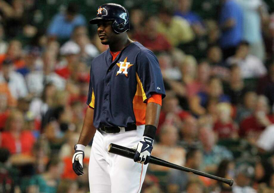 Houston Astros third baseman Matt Dominguez (30) walks back to the dugout after striking out in the seventh inning during a baseball game against the Texas Rangers, Sunday, Aug. 11, 2013, in Houston. (AP Photo/Patric Schneider) Photo: Patric Schneider, Associated Press / FR170473 AP