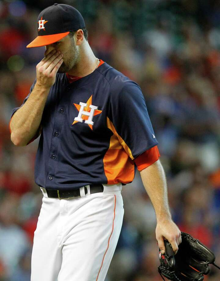Houston Astros starting pitcher Dallas Keuchel leaves the field in the ninth inning during a baseball game against the Texas Rangers, Sunday, Aug. 11, 2013, in Houston. (AP Photo/Patric Schneider) Photo: Patric Schneider, Associated Press / FR170473 AP