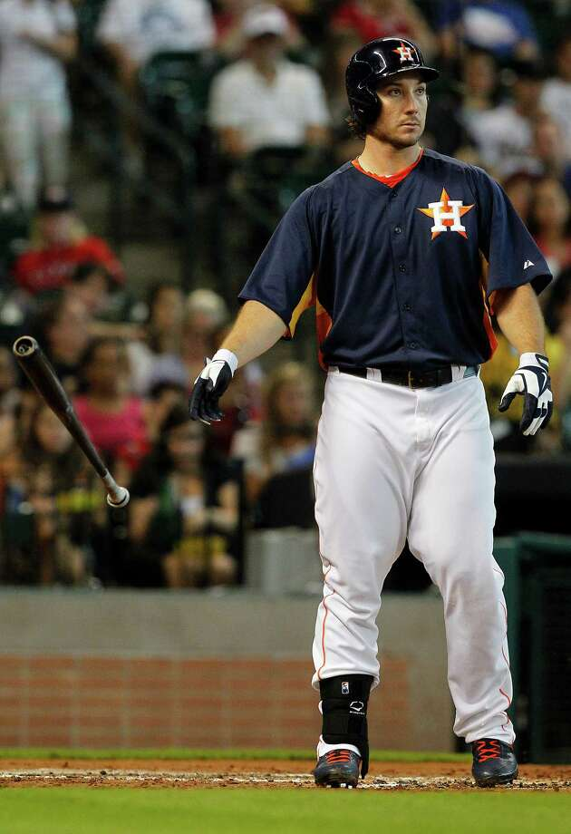 Houston Astros' Brett Wallace throws his bat after striking out in the second inning during a baseball game against the Texas Rangers, Sunday, Aug, 11, 2013, in Houston. (AP Photo/Patric Schneider) Photo: Patric Schneider, Associated Press / FR170473 AP
