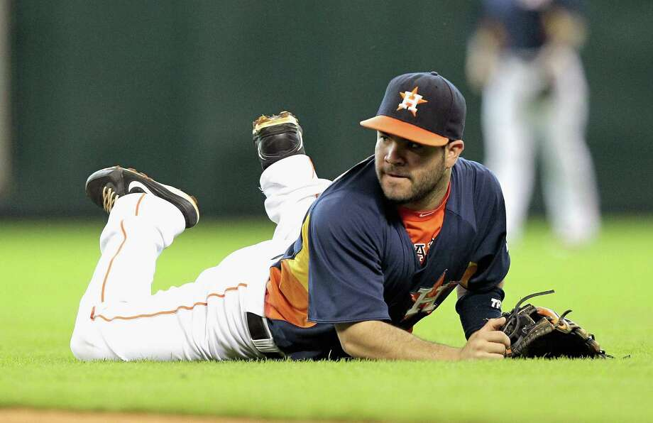 Jose Altuve #27 of the Houston Astros comes up short against the Texas Rangers at Minute Maid Park on August 11, 2013 in Houston. Photo: Bob Levey, Getty Images / 2013 Getty Images