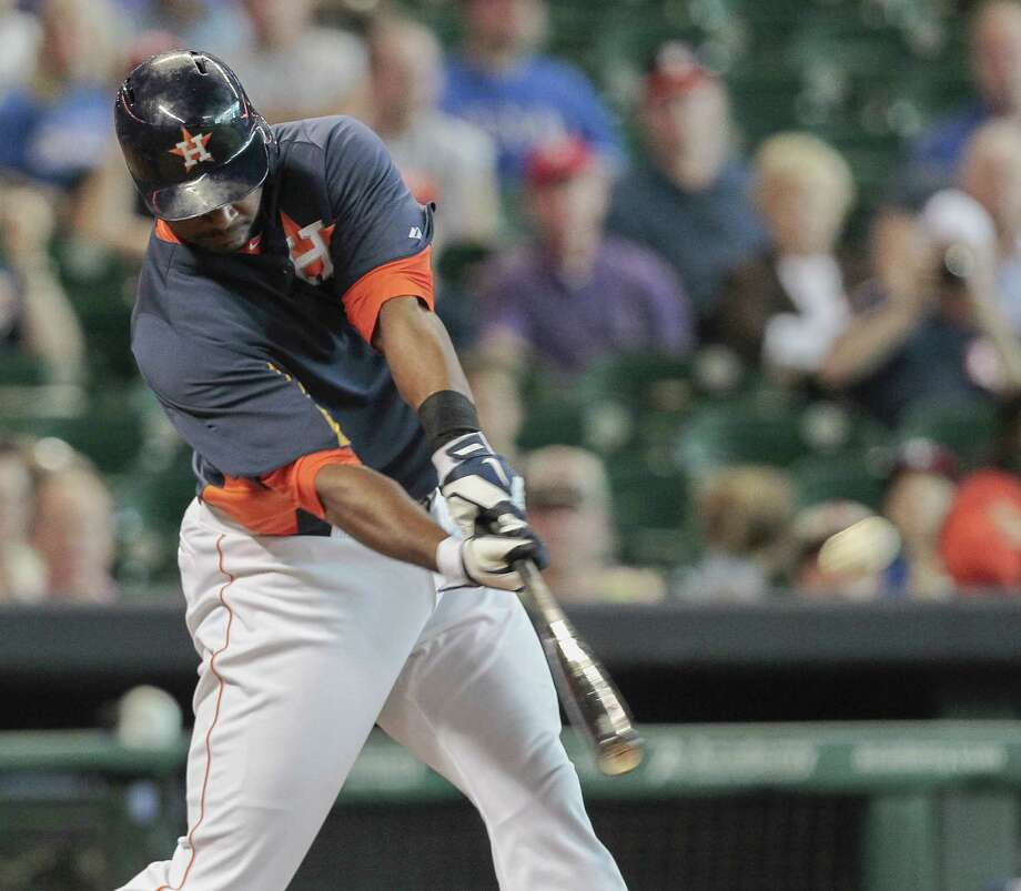 Chris Carter #23 of the Houston Astros drives a ball to left field for a home run against the Texas Rangers in the at Minute Maid Park on August 11, 2013 in Houston. Photo: Bob Levey, Getty Images / 2013 Getty Images