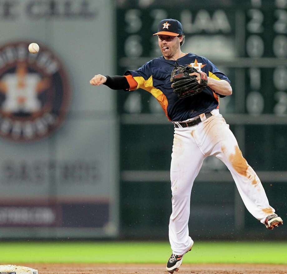 Jake Elmore #10 of the Houston Astros throws to first base to retire Jurickson Profar #13 of the Texas Rangers in the fifth inning at Minute Maid Park on August 11, 2013 in Houston. Photo: Bob Levey, Getty Images / 2013 Getty Images