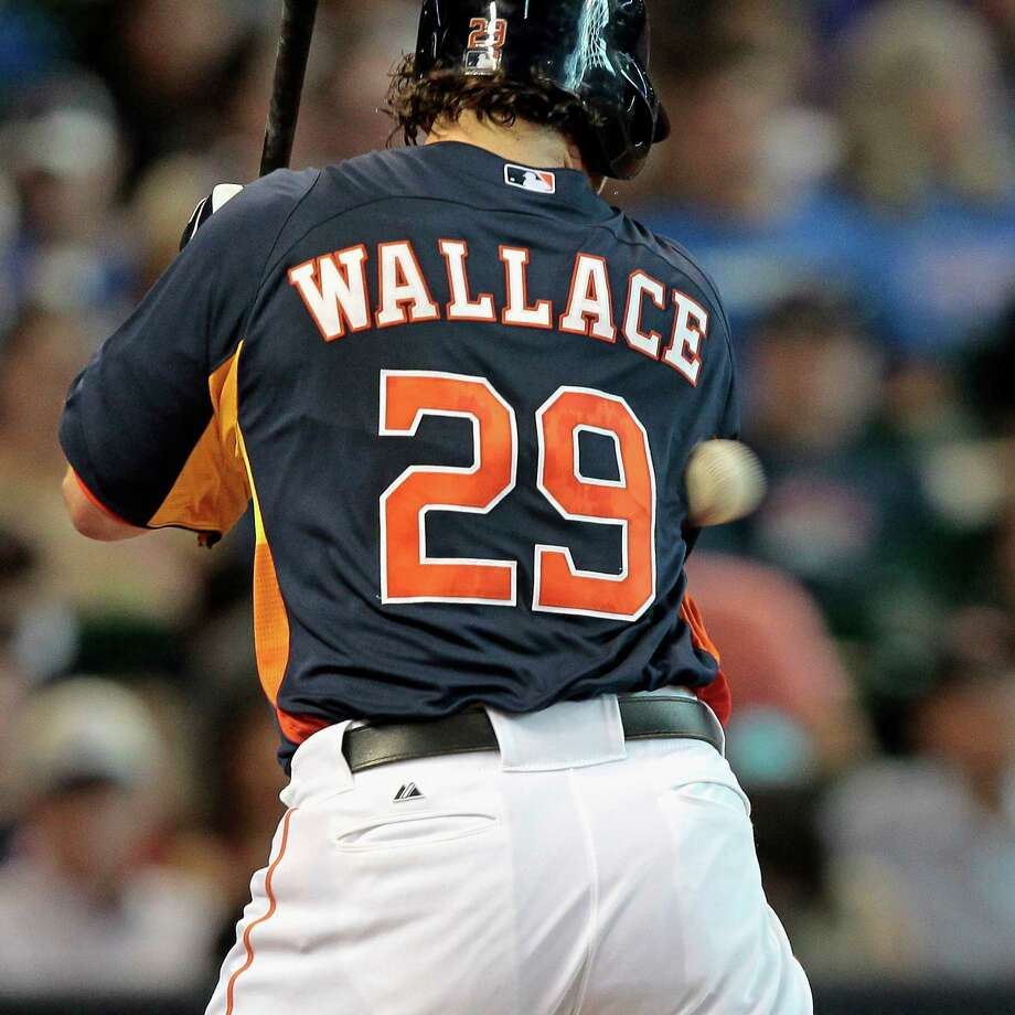 Brett Wallace #29 of the Houston Astros is hit by a pitch in the fifth inning against the Texas Rangers at Minute Maid Park on August 11, 2013 in Houston. Photo: Bob Levey, Getty Images / 2013 Getty Images