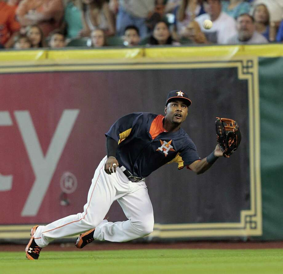 L.J. Hoes #28 of the Houston Astros makes a diving catch on a line drive hit by Adrian Beltre #29 of the Texas Rangers in the second inning at Minute Maid Park on August 11, 2013 in Houston. Photo: Bob Levey, Getty Images / 2013 Getty Images