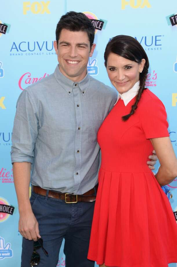 Actor Max Greenfield (L) and wife Tess Sanchez attend the Teen Choice Awards 2013 at Gibson Amphitheatre on August 11, 2013 in Universal City, California.  (Photo by Jason Merritt/Getty Images) Photo: Jason Merritt, Getty Images