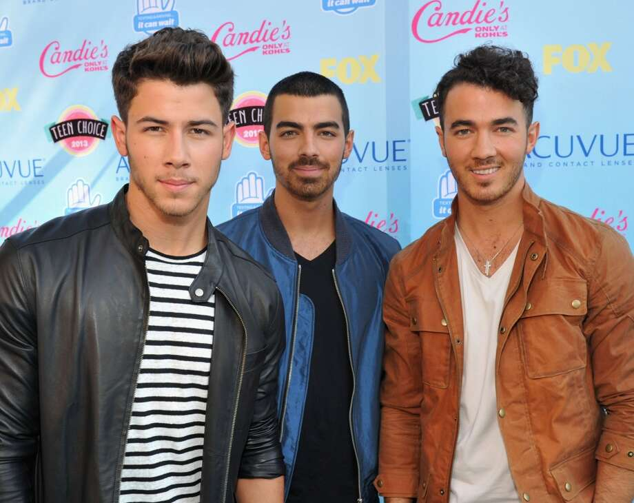 (L-R) Musicians Nick Jonas, Joe Jonas, and Kevin Jonas of the Jonas Brothers attend the 2013 Teen Choice Awards at Gibson Amphitheatre on August 11, 2013 in Universal City, California.  (Photo by Kevin Mazur/WireImage) Photo: Kevin Mazur, WireImage