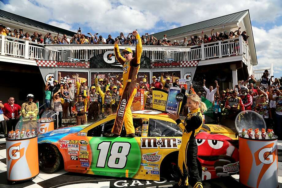 Kyle Busch stands in his car's window to join the cheering at Watkins Glen after he held off Brad Keselowski on the final two laps. Photo: Jerry Markland, Getty Images