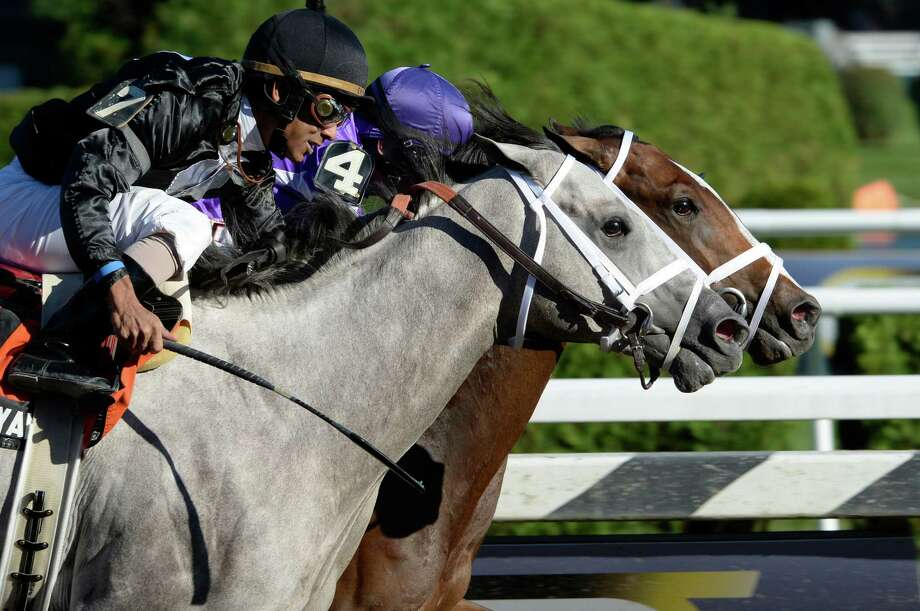 #4 Corfu with jockey John Velazquez on the rail holds off the late surge of #7 Wired Bryan to win the 108th running of The Saratoga Special Aug. 11, 2013 at the Saratoga Race Course in Saratoga Springs, N.Y.        (Skip Dickstein/Times Union) Photo: SKIP DICKSTEIN