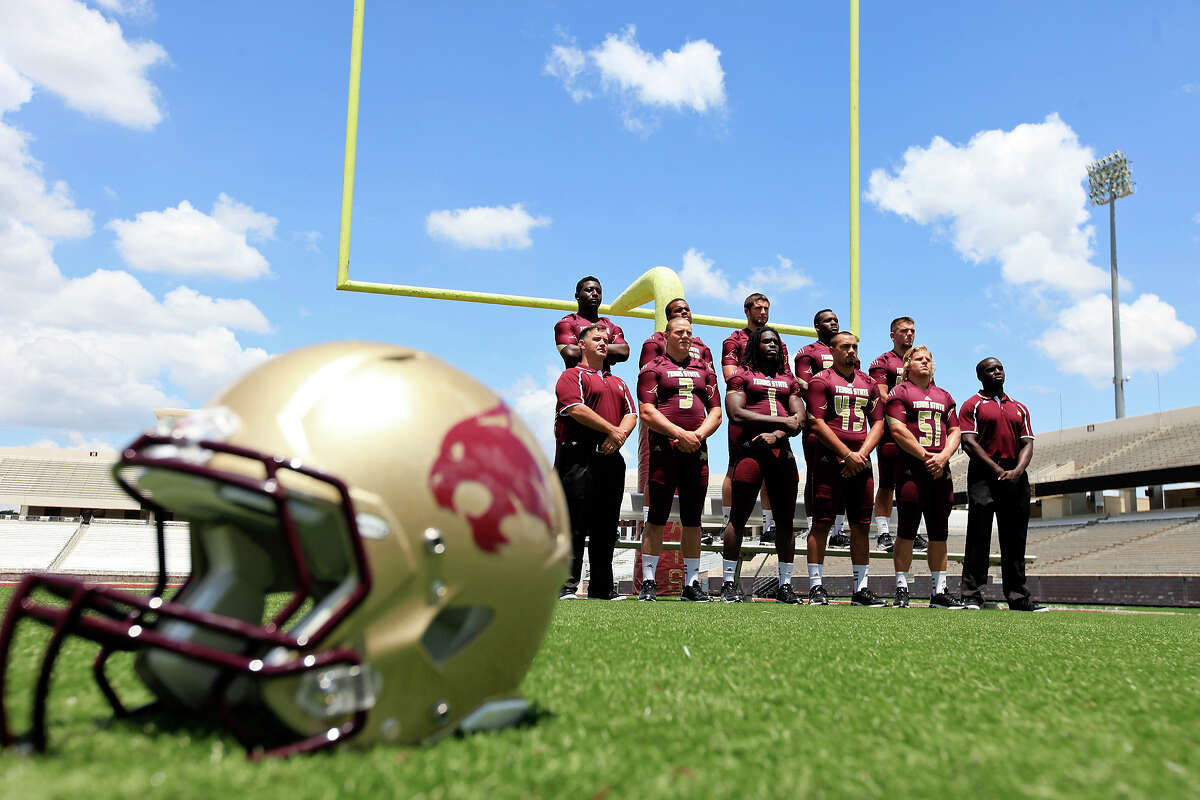 Members of the Texas State football team pose for photos during media day Sunday Aug. 11, 2013 at Bobcat Stadium in San Marcos. Read more about the Bobcats' upcoming season on ExpressNews.com.