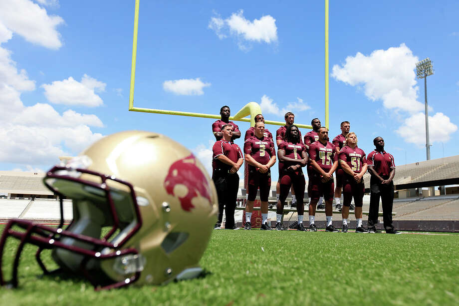 Members of the Texas State football team pose for photos during media day Sunday Aug. 11, 2013 at Bobcat Stadium in San Marcos. Read more about the Bobcats' upcoming season on ExpressNews.com. Photo: Edward A. Ornelas, San Antonio Express-News / © 2013 San Antonio Express-News