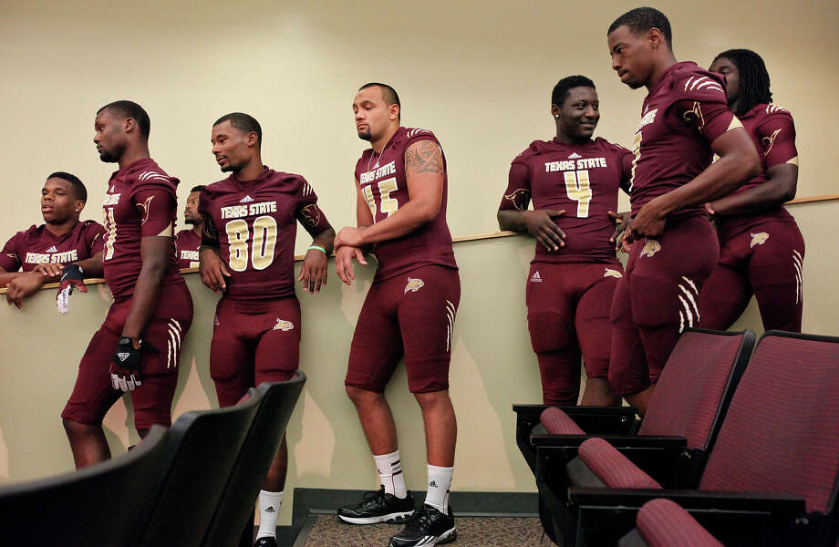Members of the Texas State football team wait to pose for the video board during media day Sunday Aug. 11, 2013 at Bobcat Stadium in San Marcos, Tx. Photo: Edward A. Ornelas, San Antonio Express-News / © 2013 San Antonio Express-News