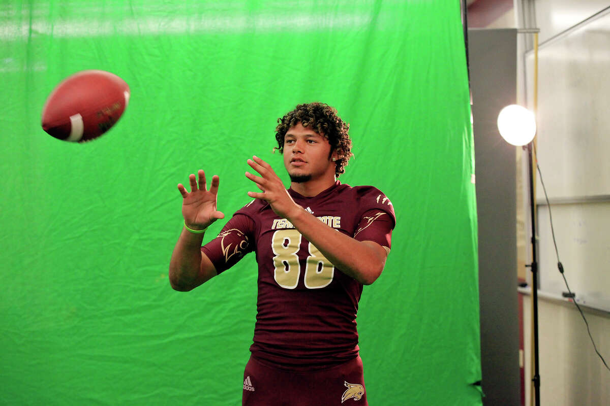 Brice Gunter poses for the video board during media day Sunday Aug. 11, 2013 at Bobcat Stadium in San Marcos, Tx.