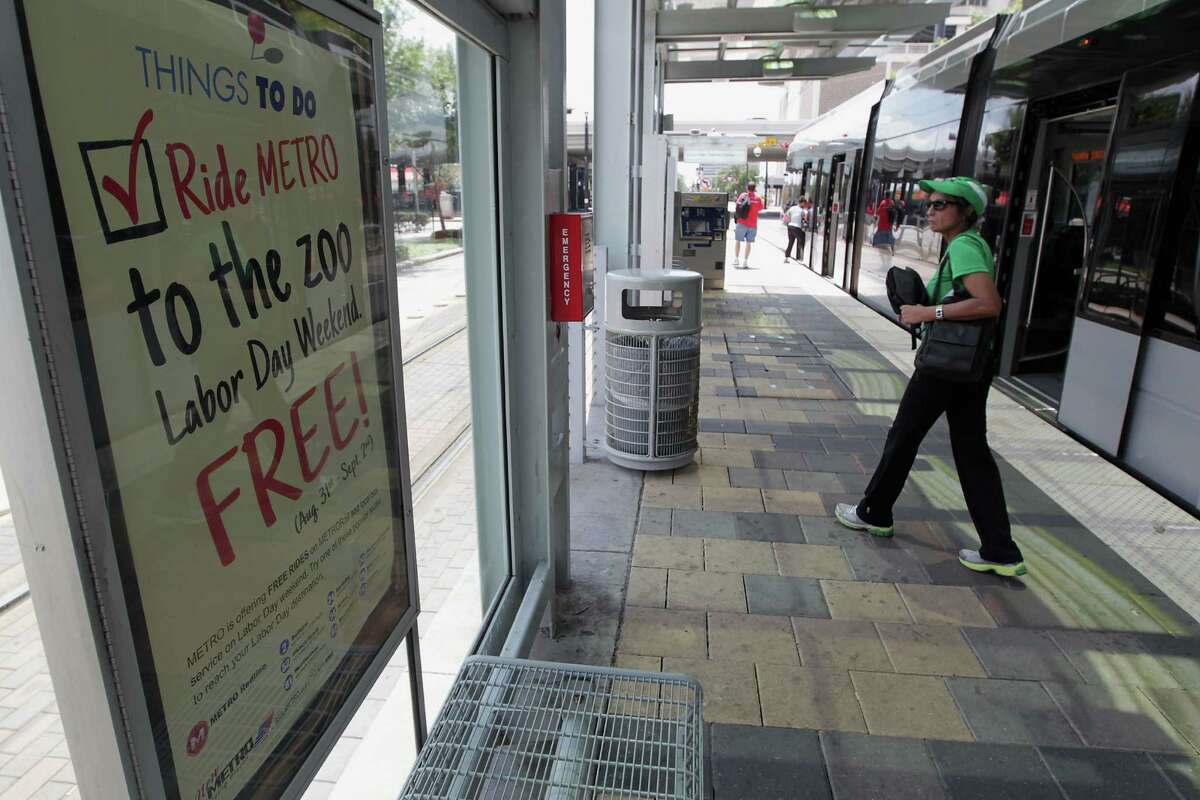 A promotional sign advertises Metro's Labor Day weekend free ride program at a light rail stop on Main Street Aug. 9 in Houston. The free rides are part of larger efforts to draw more riders.