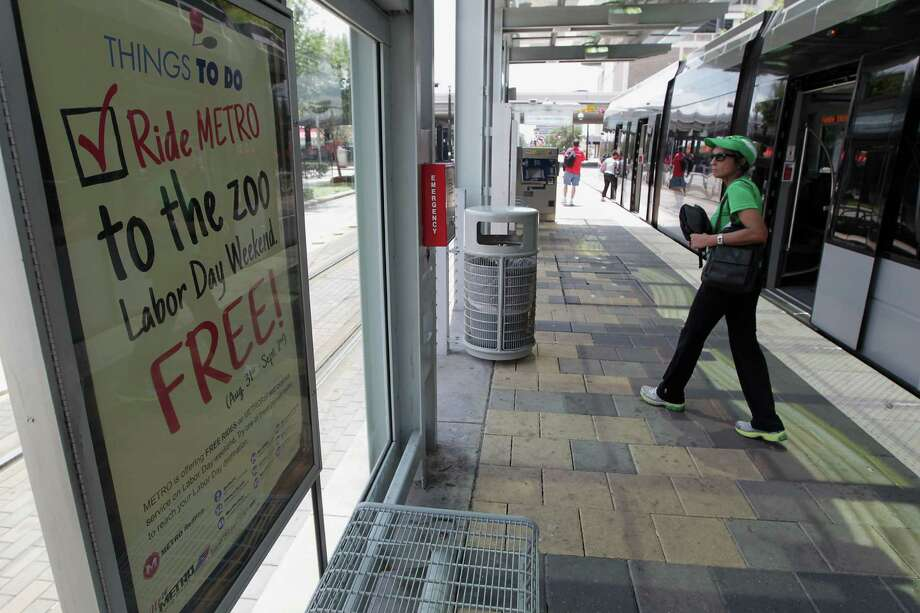 A promotional sign advertises Metro's Labor Day weekend free ride program at a light rail stop on Main Street Aug. 9 in Houston. The free rides are part of larger efforts to draw more riders. Photo: James Nielsen, Staff / © 2013  Houston Chronicle