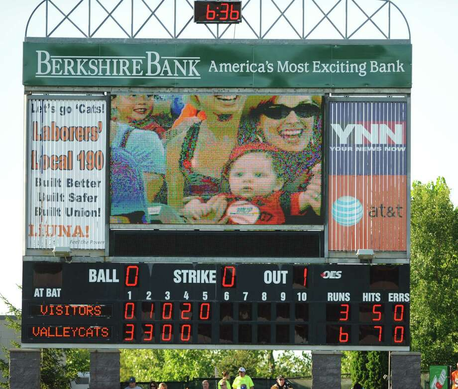 Tri-City ValleyCats pitcher scoreboard shows a woman and a baby during a baseball game against the Jamestown Jammers at Joe Bruno Stadium on Sunday, Aug. 11, 2013 in Troy, N.Y. (Lori Van Buren / Times Union) Photo: Lori Van Buren / 10023391A