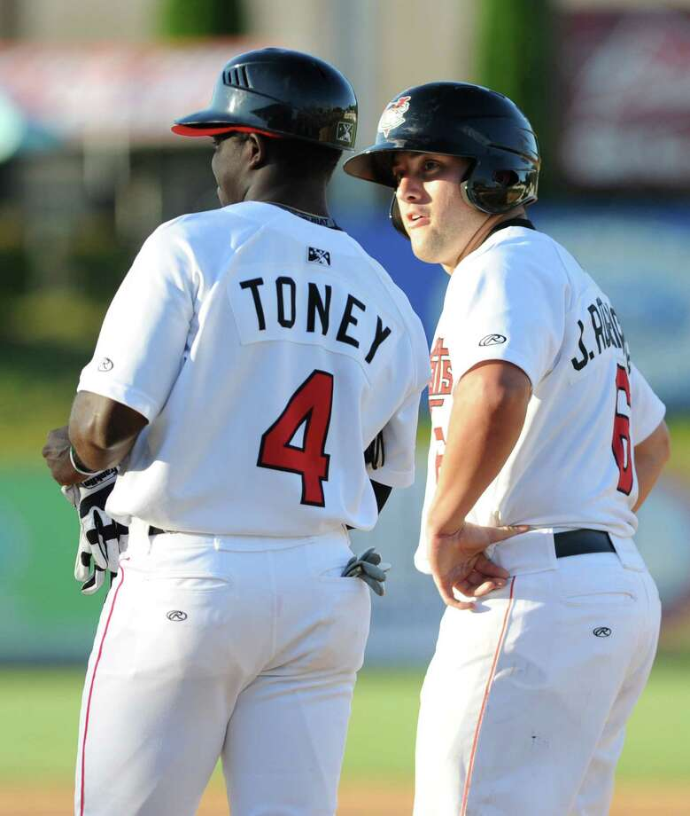 First base coach D'Andre Toney talks to Jake Rodriguez who just hit a single during a baseball game against the Jamestown Jammers at Joe Bruno Stadium on Sunday, Aug. 11, 2013 in Troy, N.Y. (Lori Van Buren / Times Union) Photo: Lori Van Buren / 10023391A