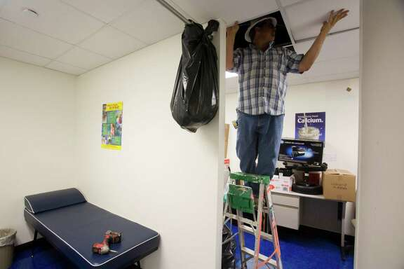 Workers remodel a charter clinic last week. The school is launching a new health care initiative that will give students access to expanded care during the school day and eventually in the community.
