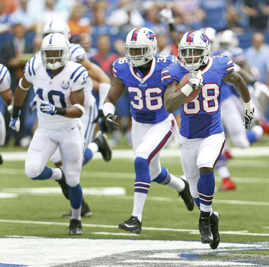 Buffalo wide receiver Marquise Goodwin (right), a rookie out of Texas, returns a kickoff 107 yards for a touchdown at Indy. Photo: Sam Riche / McClatchy-Tribune News Service