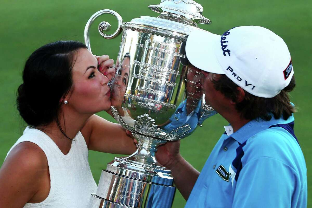 ROCHESTER, NY - AUGUST 11: Jason Dufner of the United States and his wife Amanda kiss the Wanamaker Trophy on the 18th green after his two-stroke victory at the 95th PGA Championship at Oak Hill Country Club on August 11, 2013 in Rochester, New York. (Photo by Streeter Lecka/Getty Images) ORG XMIT: 171904781