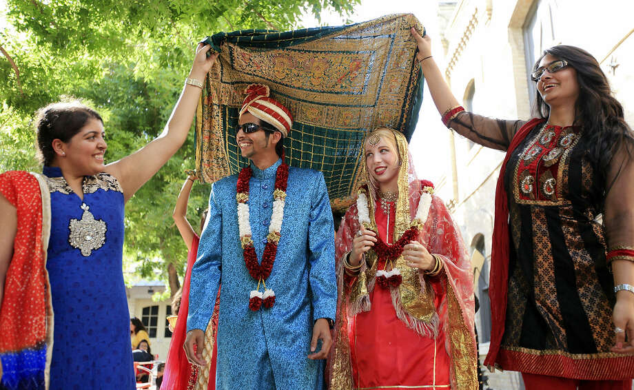 Shaya Kara (from left), Hatim Ezzi, Skylar Ginn, and Pooja Bombaywala perform a bridal parade during the Eid al-Fitr festival. Photo: Edward A. Ornelas / San Antonio Express-News